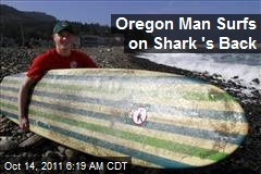 Oregon Man Surfs on Shark 's Back