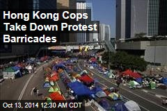 Hong Kong Cops Take Down Protest Barricades