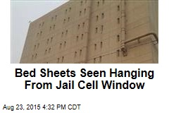 Bed Sheets Seen Hanging From Jail Cell Window