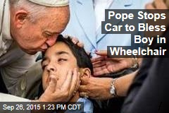 Pope Stops Car to Bless Boy in Wheelchair