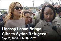 Lindsay Lohan Brings Gifts to Syrian Refugees