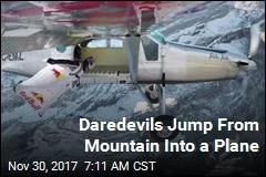 Daredevils Jump From Mountain Into a Plane