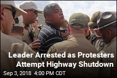 Leader Arrested as Protesters Attempt Highway Shutdown