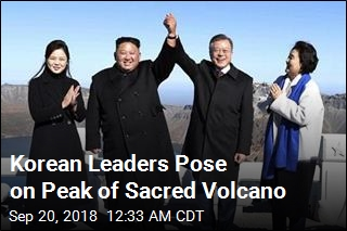 Kim, Moon Join Hands on Sacred Volcano