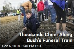 Thousands Cheer Along Bush's Funeral Train