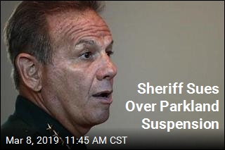 Suspended Over Parkland, Sheriff Sues