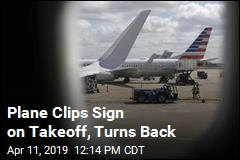 Plane Clips Sign on Takeoff, Turns Back