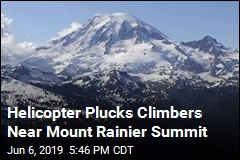 Helicopter Plucks Climbers Near Mount Rainier Summit
