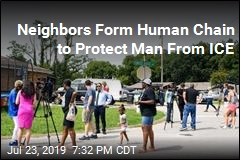Neighbors Form Human Chain to Protect Man From ICE