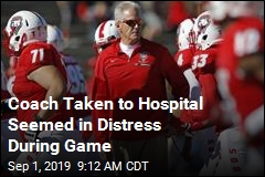 After Clutching Chest, Coach Leaves Game in an Ambulance