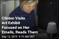 Clinton Reads Her Controversial Emails at Art Exhibit
