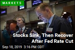 Stocks Sink, Then Recover After Fed Rate Cut