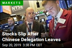 Stocks Slip After Chinese Delegation Leaves