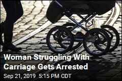 Woman Struggling With Carriage Gets Arrested