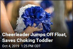 Cheerleader Jumps Off Float, Saves Choking Toddler