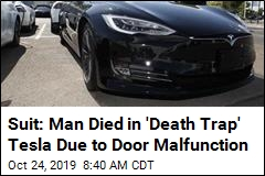 Suit: Man Died in 'Death Trap' Tesla Due to Door Malfunction