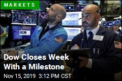 Dow Crosses 28,000 for First Time