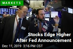 Stocks Edge Higher After Fed Announcement