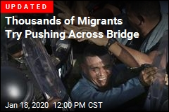 Over 1K Migrants Fill Bridge
