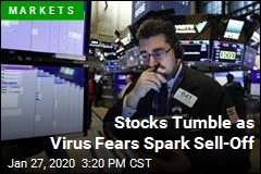 Stocks Tumble as Virus Fears Spark Sell-Off