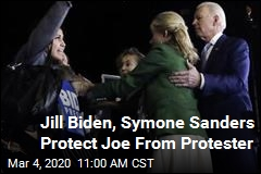Biden Protected From Protester by His Wife, Female Adviser