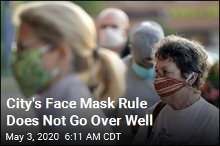 After Threats, City Kills Face Mask Rule