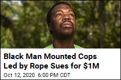 Black Man Police Led by Rope Sues for $1M