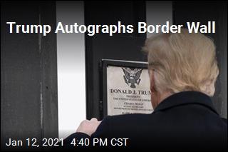 Trump Autographs Border Wall