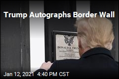 Trump Autographs Border Wall