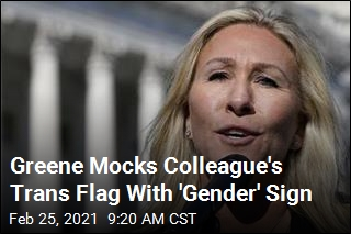 Greene Mocks Colleague's Trans Flag With 'Gender' Sign