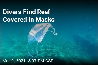 Divers Find Reef Covered in Masks