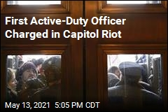 Marine Officer Charged With Breaching Capitol Doors