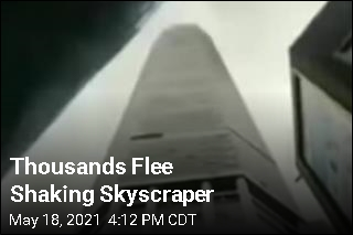 Thousands Flee Shaking Skyscraper